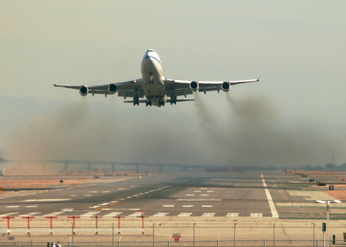 Airplane taking off runway