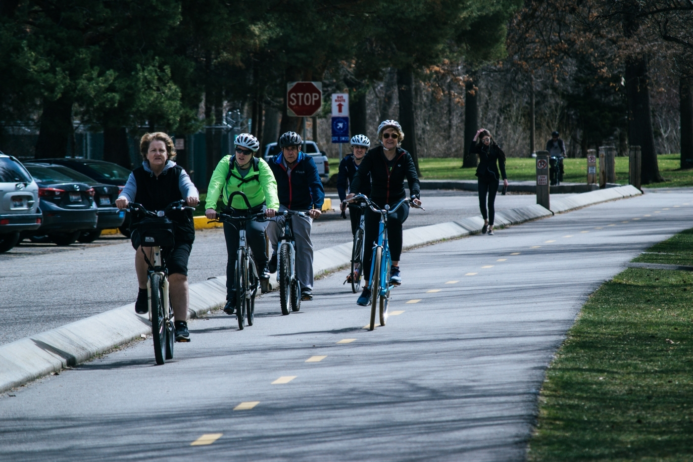 People cycling along a road