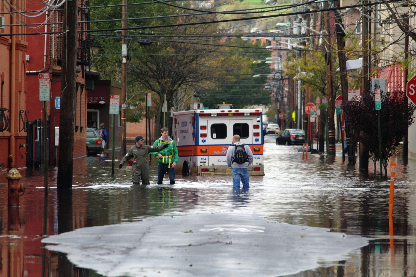 Flooded New York street with stranded ambulance